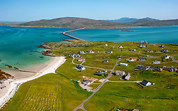 Aerial view from drone of houses in village of Balla on island of Eriskay in the Outer Hebrides, Scotland, UK
