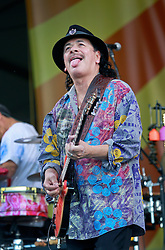 25 April 2014. New Orleans, Louisiana.<br /> Carlos Santana plays the New Orleans Jazz and Heritage Festival. <br /> Photo; Charlie Varley/varleypix.com