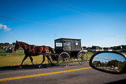 Old Order Mennonites travel by horse and buggy because they believe that the more conveniences one has, the faster-paced their life becomes. By eliminating modern conveniences and worldly distractions they are able to focus more on family and service to God. Old Order Mennonites are a branch of the Mennonite church. It is a term that is often used to refer to those groups of Mennonites who practice a lifestyle without some elements of modern technology.
