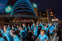 No repro fee<br /> 22-4-2018<br /> Dublin City was a sea of blue on Sunday as over 7,000 runners took to the streets for the KBC Night Run. The 10k run began at the Convention Centre finishing at the Samuel Beckett Bridge.Picture shows runners passing the Convention Centre Dublin during the KBC Night Run.Pic:Naoise Culhane-no fee