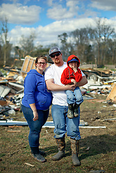 24 February 2016. Sugar Hill RV Park, Convent, Louisiana.<br /> Scenes of devastation following a deadly EF2 tornado touchdown. 2 confirmed dead. <br /> Meagan Thomas, Zachary Brown and their 4 yr old son Garrett recover all they can from their destroyed trailer.<br /> Photo©; Charlie Varley/varleypix.com