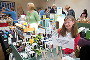 Villagers attending the local community Sunday market in the village of Husthwaite, North Yorkshire, England, UK. Over 20 stalls with a mixture of old favourites and new stalls lelling locally made products.