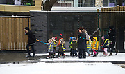 Nursery school children walk in the snow  in freezing weather, dubbed 'The Beast from the East' due to the sub zero cold temperature winds coming in from Siberia, descends on 28th February 2018 in London, United Kingdom. (photo by Jenny Matthews/In Pictures via Getty Images)