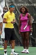 l to r: Raphael Nadal and Serena Williams at the Nike Youth Tennis  Challenge held at The Nike -Built regulation Tennis Court  on West 23rd Street & Broadway in New York  City . ..Hundreds of tennis fans and youth form New York  Parks and Rec. Athlethes for Charity, and Mentoring USA are treating to tips and guidance from Tennis Pros Roger Federer, Rafael Nadal and Serena Williams...