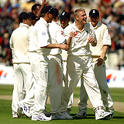 England's Andrew Flintoff is all smiles with the England camp after taking the wicket of Sri Lanka's Kumar Sangkkara.