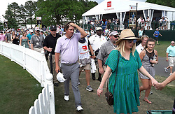May 4, 2019 - Charlotte, NC, USA - Jason Dufner, left, rubs his head as he walks with fans after play was suspended due to inclement weather at Quail Hollow Club in Charlotte, N.C., during third-round action of the Wells Fargo Championship on Saturday, May 4, 2019. (Credit Image: © TNS via ZUMA Wire)