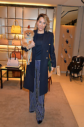 ALEX MEYERS and her dog Ribbons at a Valentine's Ladies breakfast hosted by Tod's and Carolina Bonfiglio at the Tod's boutique in New Bond Street, London on 10th February 2015.