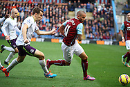 Burnley's Michael Kightly being chased by Everton's Seamus Coleman. Barclays Premier league match, Burnley v Everton at Turf Moor in Burnley, Lancs on Sunday 26th October 2014.<br /> pic by Chris Stading, Andrew Orchard sports photography.
