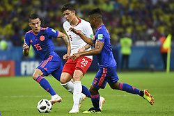 June 25, 2018 - Kazan, Russia - Dawid Kownacki of Poland fights for the ball with Wilmar Barrios and Mateus Uribe of Colombia during the 2018 FIFA World Cup Group H match between Poland and Colombia at Kazan Arena in Kazan, Russia on June 24, 2018  (Credit Image: © Andrew Surma/NurPhoto via ZUMA Press)