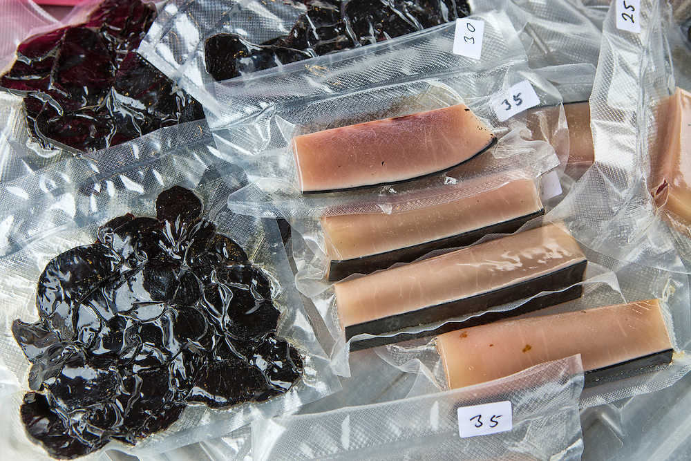 Torshavn Harbor, Streymoy Island, Faroe Islands.<br />  <br /> Pilot whale meat for sale in the harbor.  The black meat is dried pilot whale, and the salmon colored meat is the blubber.  The faroese think of the whale meat as a delicacy, and while the meat is filled with mercury, they continute the tradition of the whale slaughter each year, and continue to eat the meat.