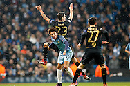 Manchester City's Leroy Sane (19) and Celtic's Mikael Lustig (23) during the Champions League match between Manchester City and Celtic at the Etihad Stadium, Manchester, England on 6 December 2016. Photo by Craig Galloway.