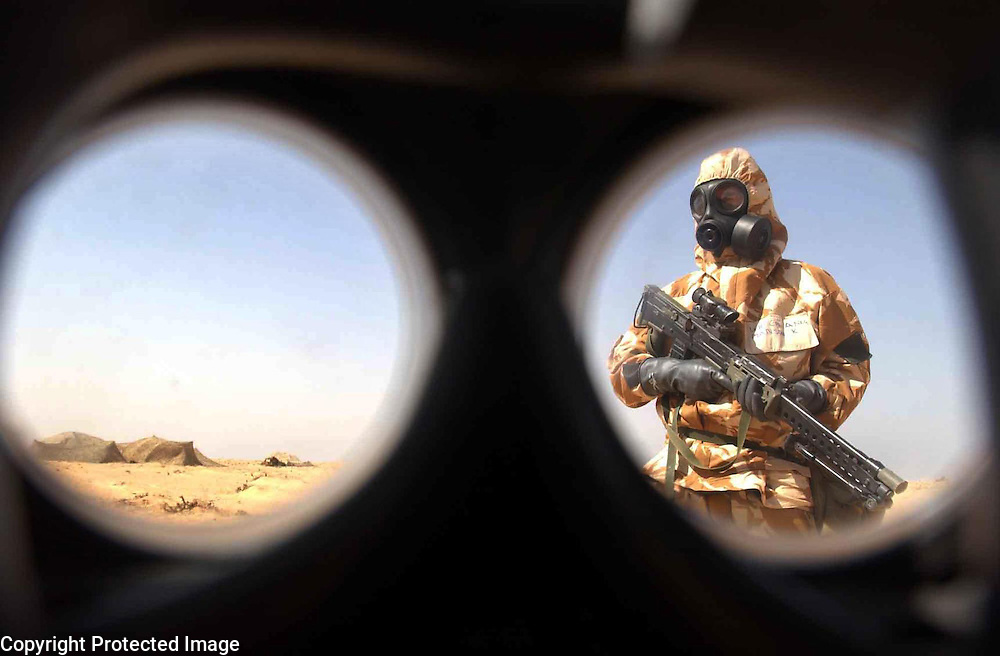 PIC BY PAUL GROVER IN NORTHERN KUWAIT WITH THE QUEENS DRAGOON GUARDS 3 COMMANDO PIC SHOWS TAKEN THROUGH A NBC RESPIRATOR KEVIN MANSON FROM EDINBURGH IN NBC SUIT AND EQUIPMENT IN THE HEAT OF THE DESERT PIC PAUL GROVER