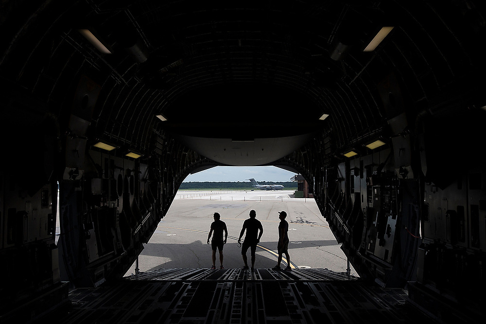 3 Doors Down band members stand at the end of the cargo bay of a C-17 during a flight line tour before the concert. <br /> MusicFest at Joint Base Charleston featuring Linkin' Bridge, Thompson Square and 3 Doors Down on Saturday, July 29, 2017. <br /> Zach Bland Photo