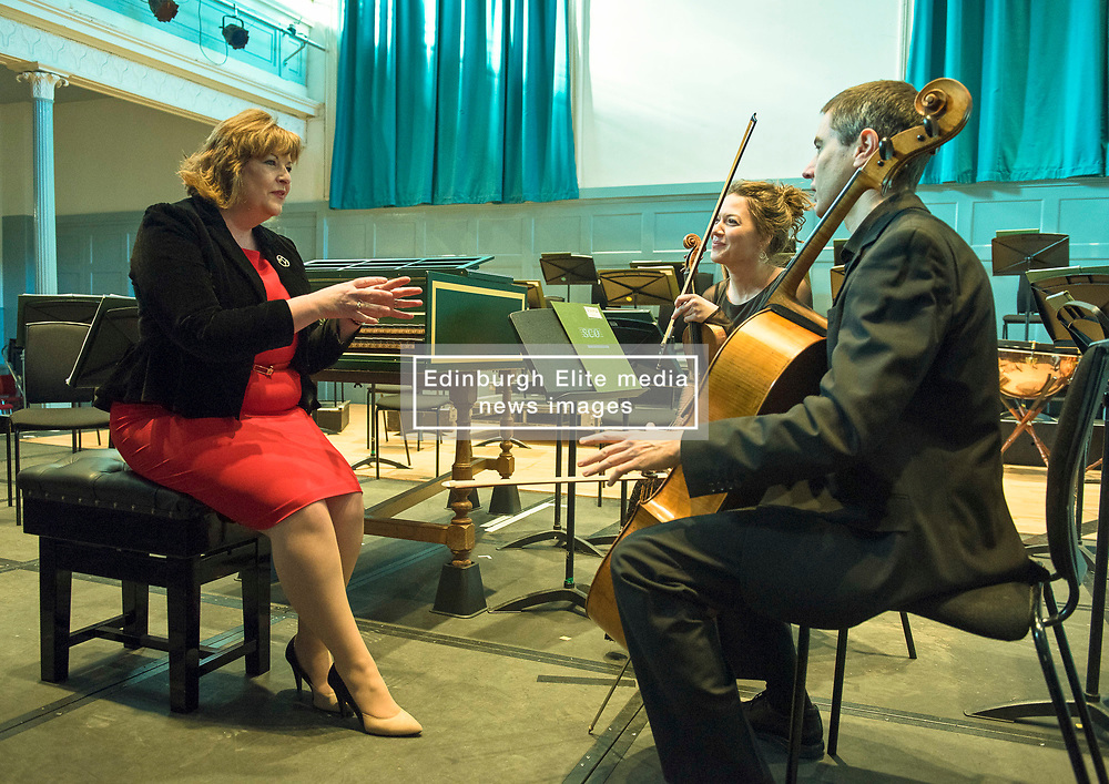 Pictured: Fiona Hyslop, Culture Secretary chats with musicians Marciana Buta (violin) and Donald Gillan (cello)<br /> Culture Secretary Fiona Hyslop announced a £650,000 grant for building improvements at the Queen's Hall, Edinburgh. <br /> <br /> © Jon Davey/ EEm