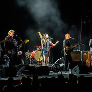 VIENNA, VA - July 21st, 2017 - PJ Harvey (center) performs at the Filene Center at Wolf Trap in Vienna, VA. A trip to Washington, D.C. in 2016 inspired much of Harvey's latest album, The Hope Six Demolition Project. (Photo by Kyle Gustafson / For The Washington Post)