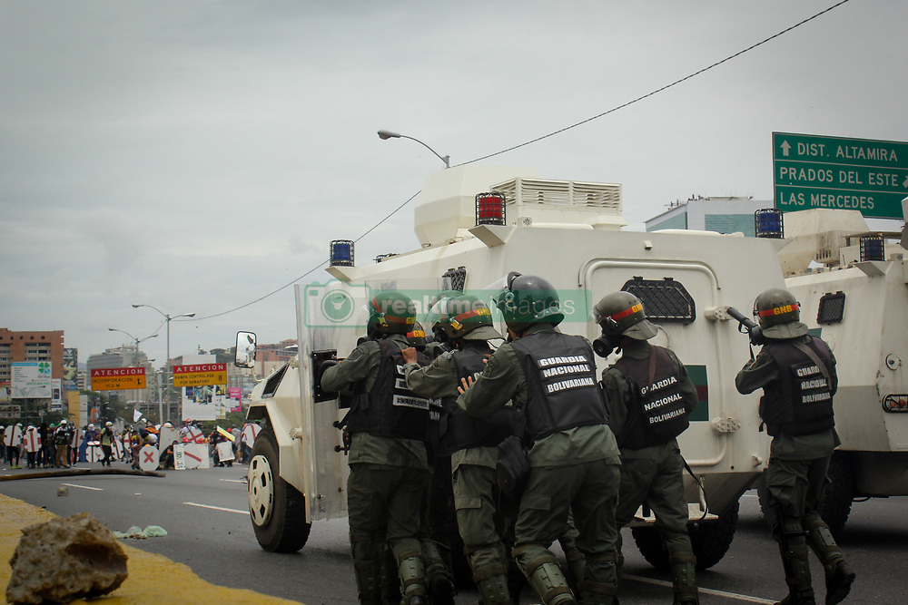 Bolivarian National Guard personnel fire tear gas at protesters protesting against President Nicolas Maduro this May 3, 2017 on the Francisco Fajardo motorway.