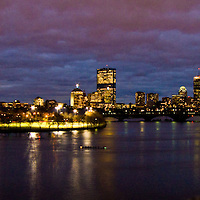 View from Cambridge, view of boston skyline and part of the esplinade at night.