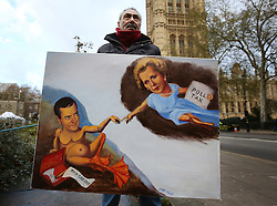 © Licensed to London News Pictures. 25/11/2015. London, UK. Artist Kaya Mar holds his cartoon depicting Chancellor of the Exchequer George Osborne and former Prime Minister Margaret Thatcher as the Chancellor presents his Spending Review and Autumn Budget Statement to Parliament. Photo credit: Peter Macdiarmid/LNP