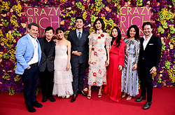 (From left to right) Josh Berger, Ken Jeong, Constance Wu, Henry Golding, Gemma Chan, Awkwafina, Jing Lusi and Producer John Penotti attending the Crazy Rich Asians Premiere held at Ham Yard Hotel, London.