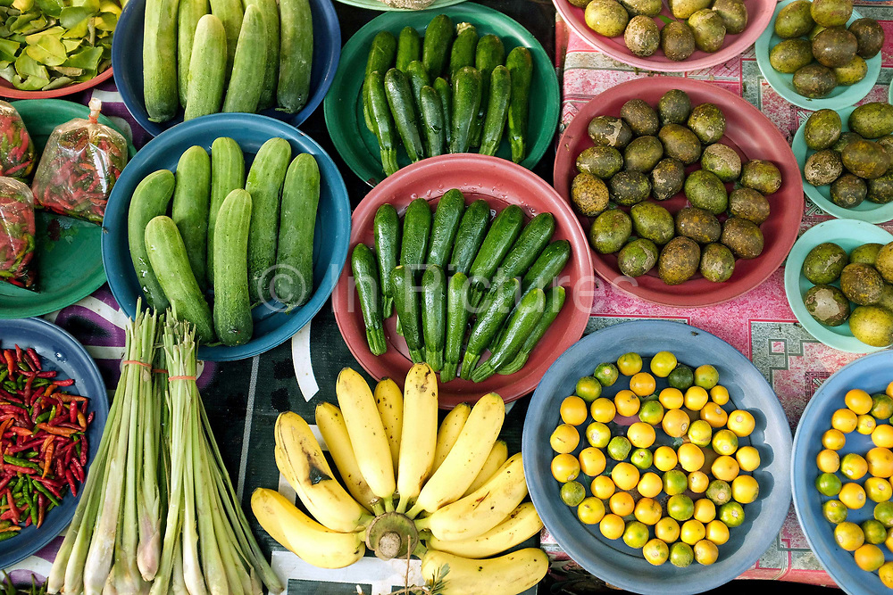 Local fruit and vegetables for sale at Dong Mak Kai market on the outskirts of Vientiane, Lao PDR. A large variety of local products are available for sale in fresh markets all over Laos, all being sold on small individual stalls.