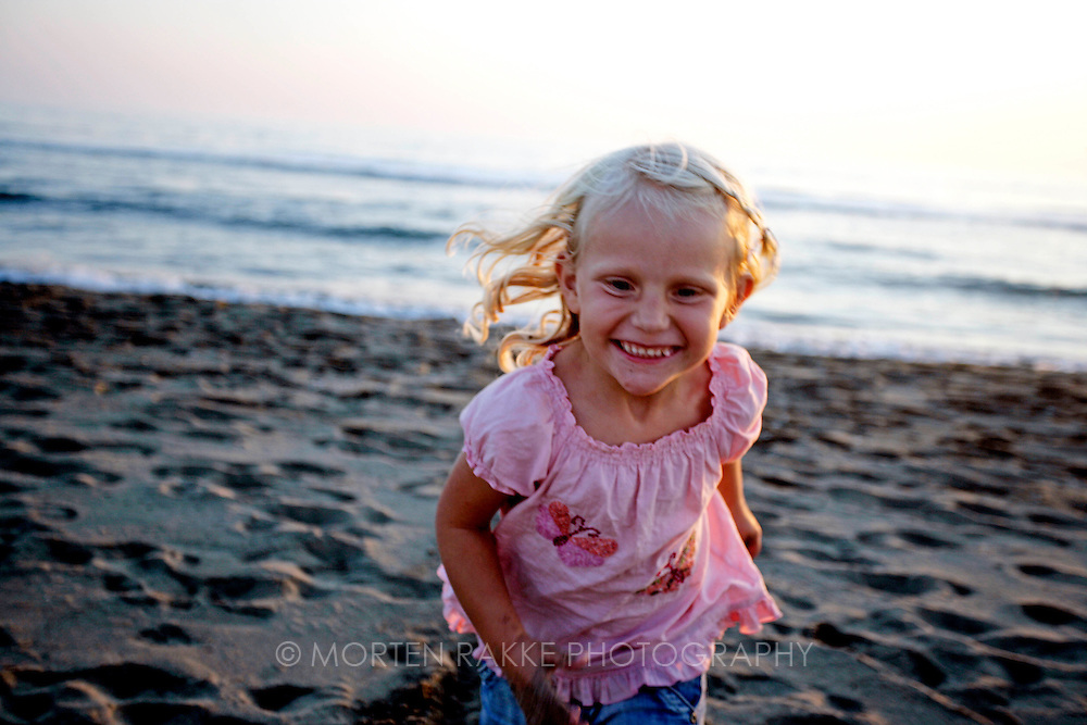 Girl play at beach, Italy
