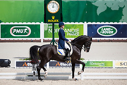 Inna Logutenkova, (UKR), Don Gregorius - Grand Prix Team Competition Dressage - Alltech FEI World Equestrian Games™ 2014 - Normandy, France.<br /> © Hippo Foto Team - Leanjo de Koster<br /> 25/06/14