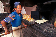 PERU, HIGHLANDS, CUZCO AREA Pisac Village in the Valley of the Incas; Sunday Market, one of the world's most colorful markets; village baker