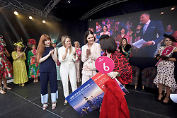 Girls Aloud singer Nicola Roberts, left of judging panel, presenting winner of Queen of Style to Lynsey McGill of South Queensferry at Musselburgh races Laidies Day pic Terry Murden @edinburghelitemedia