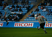 Photo: Steve Bond.<br />Coventry City v Notts County. The Carling Cup. 14/08/2007. Kevin Pilkington clears as Leon Best rushes in (L)
