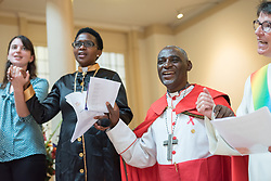 """23 July 2018, Amsterdam, the Netherlands: Religious leaders from a range of religions and traditions sing """"We shall overcome"""" together"""", """"...deep in my heart, I do believe, we'll be joining hands one day..."""". On 23 July, an international Interfaith Memorial and Prayer Service takes place in the Keizersgrachtkerk in Amsterdam, the Netherlands. Gathering local congregants together with international guests, the service takes place in connection with the 2018 International AIDS Conference, held in Amsterdam on 23-27 July."""