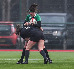 Ireland women's Anna Caplice is tackled by Wales women's Natalia John<br /> <br /> Photographer Craig Thomas/Replay Images<br /> <br /> International Friendly - Wales women v Ireland women - Sunday 21th January 2018 - CCB Centre for Sporting Excellence - Ystrad Mynach<br /> <br /> World Copyright © Replay Images . All rights reserved. info@replayimages.co.uk - http://replayimages.co.uk