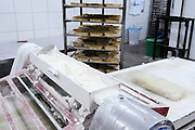 Industrial Bakery, cooky dough on a kneading and rolling belt