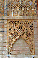 Arabesque Mudjar plaster work of the entrance to Don Pedro's Palace, completed in 1366. Alcazar of Seville, Seville, Spain . The Royal Alcázars of Seville (al-Qasr al-Muriq ) or Alcázar of Seville, is a royal palace in Seville, Spain. It was built by Castilian Christians on the site of an Abbadid Muslim alcazar, or residential fortress.The fortress was destroyed after the Christian conquest of Seville The palace is a preeminent example of Mudéjar architecture in the Iberian Peninsula but features Gothic, Renaissance and Romanesque design elements from previous stages of construction. The upper storeys of the Alcázar are still occupied by the royal family when they are in Seville. <br /> <br /> Visit our SPAIN HISTORIC PLACES PHOTO COLLECTIONS for more photos to download or buy as wall art prints https://funkystock.photoshelter.com/gallery-collection/Pictures-Images-of-Spain-Spanish-Historical-Archaeology-Sites-Museum-Antiquities/C0000EUVhLC3Nbgw <br /> .<br /> Visit our MEDIEVAL PHOTO COLLECTIONS for more   photos  to download or buy as prints https://funkystock.photoshelter.com/gallery-collection/Medieval-Middle-Ages-Historic-Places-Arcaeological-Sites-Pictures-Images-of/C0000B5ZA54_WD0s