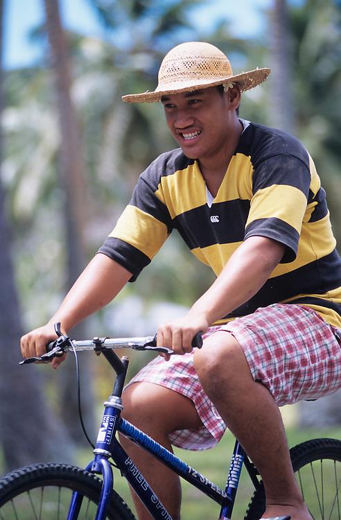 Cook Islands, K?ki '?irani, South Pacific Ocean, Aitutaki,young man on bike