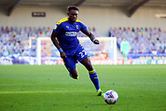 AFC Wimbledon defender Darnell Johnson (27) dribbling during the EFL Sky Bet League 1 match between AFC Wimbledon and Hull City at Plough Lane, London, United Kingdom on 27 February 2021.