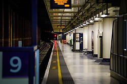 © Licensed to London News Pictures. 14/12/2016. London, UK. An empty Southern Rail platform at 5:00pm afternoon rush hour at Victoria Station on 14 December 2016, as hundreds of thousands of rail passengers face a second day of a 3 day all-out strike in an escalating dispute over the role of conductors between Southern Rail and the RMT Union. Photo credit: Ben Cawthra/LNP