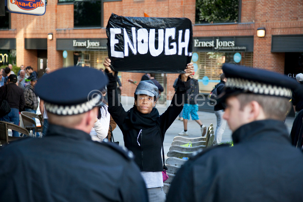 """Protesters make their point to lines of police blocking their exit. Occupy London protest, October 15th 2011. Protest spreads from the US with this demonstrations in London and other cities worldwide. The 'Occupy' movement is spreading via social media. After four weeks of focus on the Wall Street protest, the campaign against the global banking industry started in the UK this weekend, with the biggest event aiming to """"occupy"""" the London Stock Exchange. The protests have been organised on social media pages that between them have picked up more than 15,000 followers. Campaigners gathered outside  at midday before marching the short distance to Paternoster Square, home of the Stock Exchange and other banks.It is one of a series of events planned around the UK as part of a global day of action, with 800-plus protests promised so far worldwide.Paternoster Square is a private development, giving police more powers to not allow protesters or activists inside."""