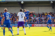 AFC Wimbledon defender Ryan Delaney (21) winning header during the EFL Sky Bet League 1 match between AFC Wimbledon and Shrewsbury Town at the Cherry Red Records Stadium, Kingston, England on 14 September 2019.