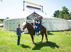 """Giffords Circus presents """"Xanadu"""" <br /> Produced by Nell Gifford  - Directed by Cal McCrystal<br /> At Chisiwck House and Park, London, Great Britain <br /> Press view <br /> 27th June 2019 <br /> <br /> 7th and 8th generation horse-people The Donnert Family from hungry performing in the UK for the first time at Giffords Circus<br /> <br /> <br /> <br /> Roll up, roll in to the stately pleasure-dome for miracles, song, symphony and enchantment. Musicians, horses, clowns and tumblers enfolded in this joyful paradise, with music loud and long - the Giffords Circus caravan will be taking to the road for a 2019 summer of love.<br /> <br /> <br /> It is midsummer 1973 in Hyde Park and the flower power movement is at its height. Hippies, hipsters, rock stars, musicians, wild women and global nomads with Shamanic horses gather to play, sing, dance, protest and perform. Policemen and a family of out-of-towners get caught up in the celebrations. Will they get in the groove? Nell Gifford builds a pleasure dome and Tweedy has a job in the kitchen as he thought everyone was talking about """"Flour Power"""". As evening approaches, the ever more chaotic event careers towards a joyful, transcendental finale. <br /> <br /> Photograph by Elliott Franks"""