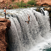 Arizona Outback Adventures, based in Scottsdale, AZ, leads a 4-day hiking trip of Havasupai Falls within the Grand Canyon in Arizona. Visitors jump from the top of one of the many waterfalls down in the canyon.