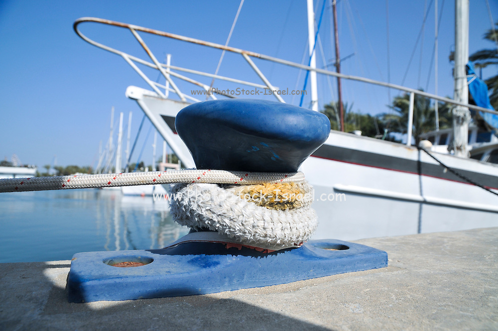 Moored yacht tied to a bollards on the wharf
