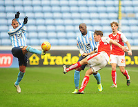 Fleetwood Town's Eggert Jonsson clears under pressure from Coventry City's Marcus Tudgay, left and Coventry City's Marc-Antoine Fortune, right<br /> <br /> Photographer Andrew Vaughan/CameraSport<br /> <br /> Football - The Football League Sky Bet League One - Coventry City v Fleetwood Town - Saturday 27th February 2016 - Ricoh Stadium - Coventry   <br /> <br /> © CameraSport - 43 Linden Ave. Countesthorpe. Leicester. England. LE8 5PG - Tel: +44 (0) 116 277 4147 - admin@camerasport.com - www.camerasport.com