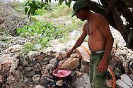 Making tomato sauce near Gibara, Holguin Province, Cuba.