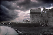 A flock of sheep gather at an old castle in Spain as a big storm comes into the area