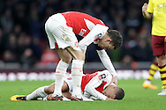 Kieran Gibbs of Arsenal (on ground) lies injured after Andre Gray of Burnley elbowed the Arsenal player in the stomach. The Emirates FA cup, 4th round match, Arsenal v Burnley at the Emirates Stadium in London on Saturday 30th January 2016.<br /> pic by John Patrick Fletcher, Andrew Orchard sports photography.