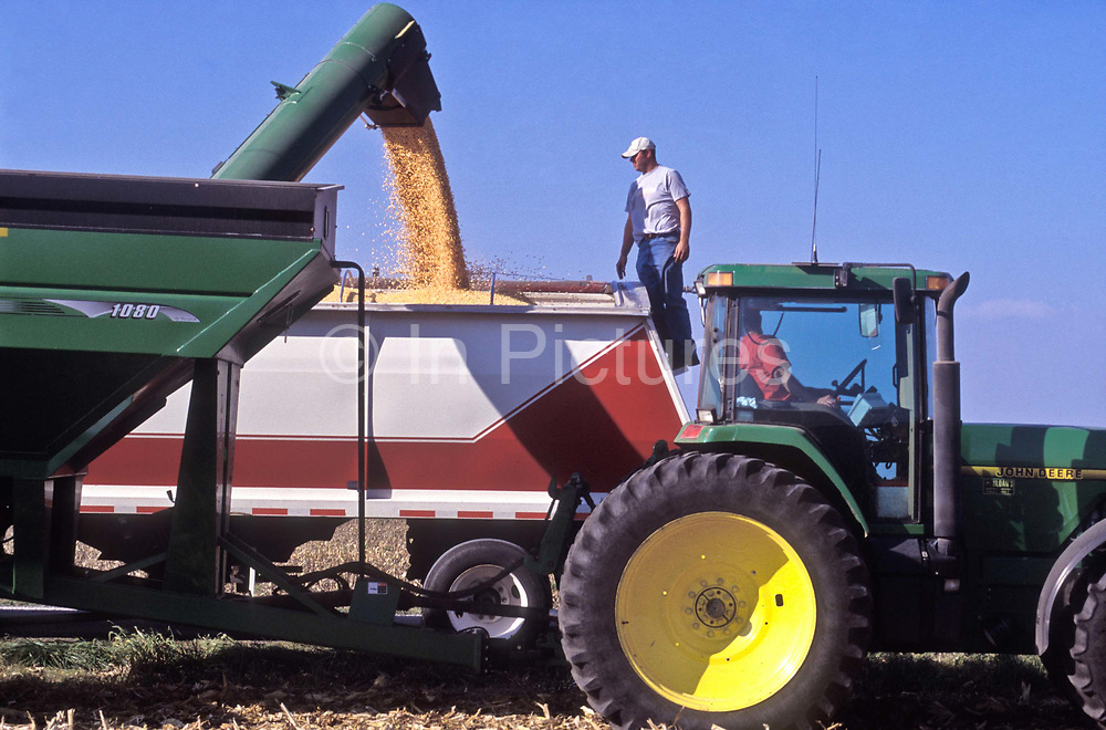 A farmer oversees the loading of Corn in America's Corn belt of Illinois state, USA.