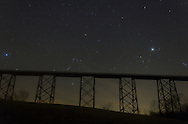 Salisbury Mills, New York - Stars in the night sky above the Moodna Viaduct railroad trestle on Dec. 14, 2012. The consellation Orion, with its belt of three stars, is just above the trestle. The planet Jupiter is at right, above the V-shaped constellation Taurus.