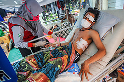 October 4, 2018 - Palu, Central Sulawesi, Indonesia - A resident seen reviving treatment at Anutapura Hospital after the earthquake.  A deadly earthquake measuring 7.7 magnitude and the tsunami wave caused by it has destroyed the city of Palu and much of the area in Central Sulawesi. According to the officials, death toll from devastating quake and tsunami rises to 1,347, around 800 people in hospitals are seriously injured and some 62,000 people have been displaced in 24 camps around the region. (Credit Image: © Hariandi Hafid/SOPA Images via ZUMA Wire)