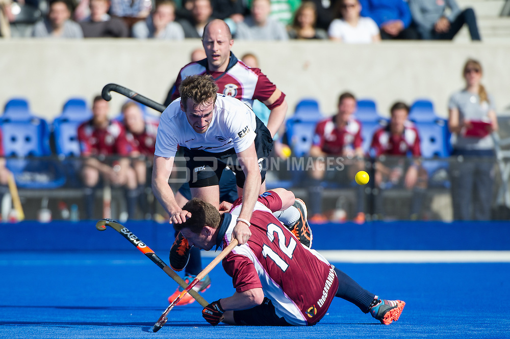 East Grinstead's Chris Griffiths get taken out by Michael Hoare of Wimbledon. East Grinstead v Wimbledon -  Now: Pensions Men's Hockey League Championship Final, Lee Valley Hockey & Tennis Centre, London, UK on 12 April 2015. Photo: Simon Parker