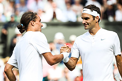 LONDON, July 5, 2017  Switzerland's Roger Federer (R) shakes hands with Ukraine's Alexandr Dolgopolov after their men's singles first round match at the Championship Wimbledon 2017 in London, Britain, on July 4, 2017. Federer advanced to the second round after Dolgopolov retired due to injury. (Credit Image: © Han Yan/Xinhua via ZUMA Wire)